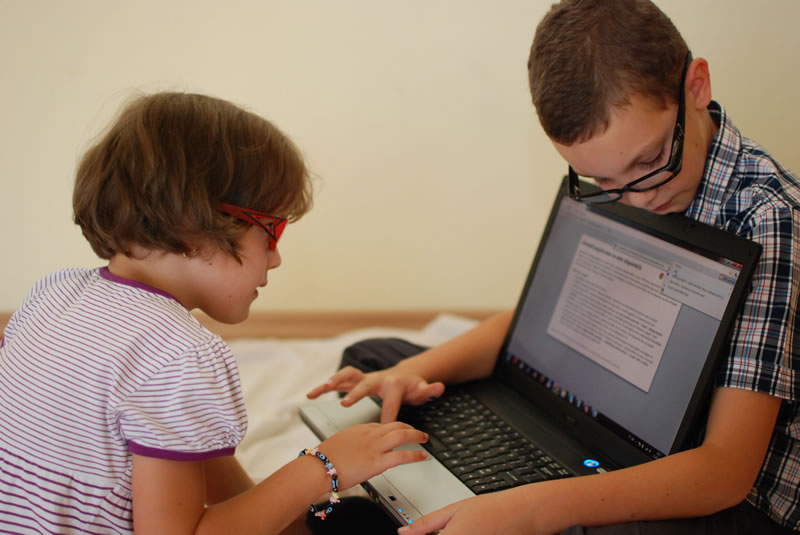 Kids with Computer Glasses playing on laptop